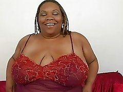 Fat ebony momma with huge bosom plays with her shaved taco