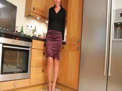 blond babe in kitchen teasing hard