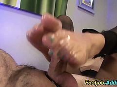 Footjob with cumshot from slut in pantyhose