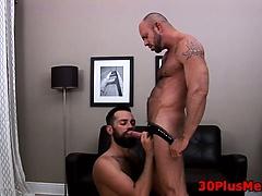 Bear sucking cock and giving handjob