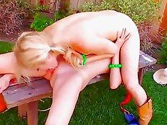 Lesbians doing 69 in the garden