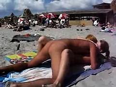 Couple having sex on the nude beach