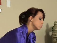 Gorgeous brunette rubs lesbian