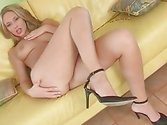 Sexy naked babe Roxy Carter gets too hot to handle on her couch naked