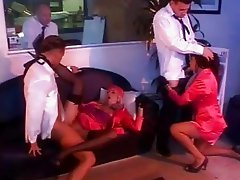Two beautiful stewardesses plays with two pilots