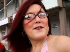 Chubby redhead milf with glasses works her mouth on a big black pole