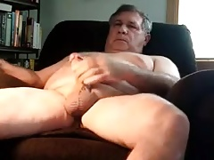 A older man masturbating in armchair