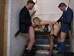 Busty bimbo in lingerie and heels enjoys a basement threesome