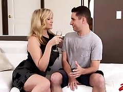 Julia Ann is having steamy sex with a young guy who loves her
