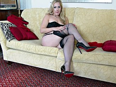Sexy blonde MILF in lingerie masturbates on sofa
