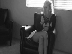 Blonde bombshell enjoys a cigarette before taking it up her