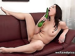 Big fat green dildo pleasures the cunt of a cute slut