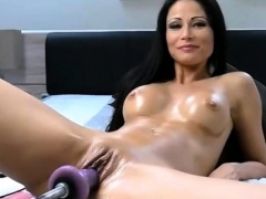 Brunette babe takes two toys in her pussy