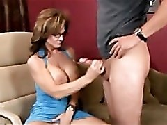 Milf Deauxma shows her tits and strokes a cock