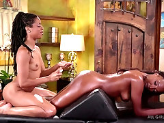 Black lesbians take turns pleasing each other in a massage