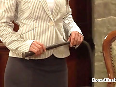 Mature woman disciplines a young woman with a big whip