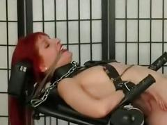 Redhead spanked shocked and waxed on a bondage bench BDSM