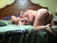 Two busty lesbian milfs fuck each other with a big dildo