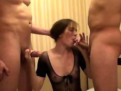 MILF in sexy see-through top gets her face fucked by two men