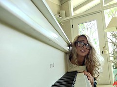 janice griffith bends over the piano and gets drilled by her teacher