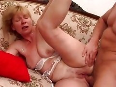 80s blonde granny is having hardcore fuck with young guy on vintage couch