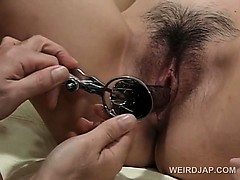 Pregnant asian gets hairy pussy opened with speculum